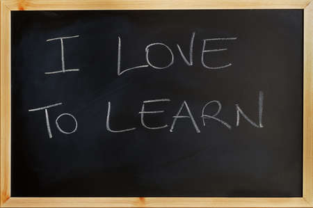 i love to learn written on a blackboard photo