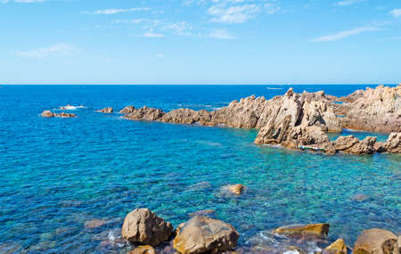 Costa Paradiso rocky shore on a clear day photo