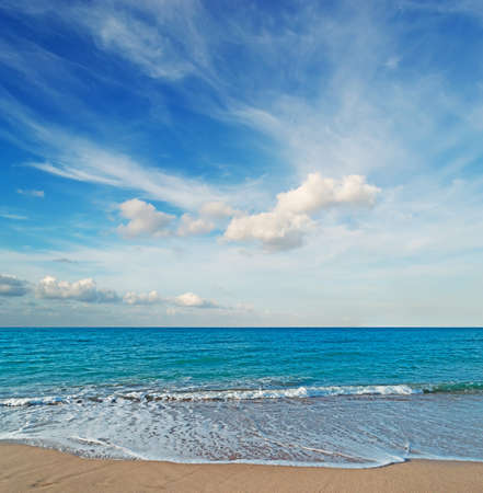 frothy: frothy shore and scenic clouds in Sardinia Stock Photo