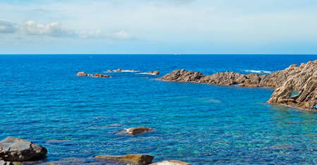 Costa Paradiso rocky shore on a cloudy day photo