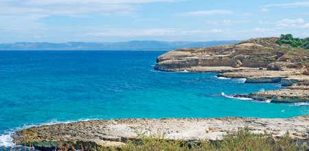 torres: rocky shoreline in Porto Torres, Sardinia Stock Photo