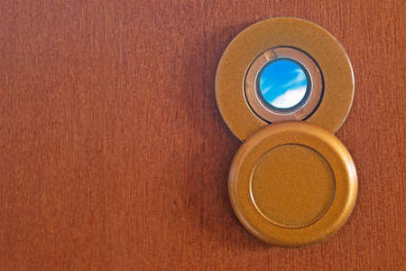 eyewitness: peephole on a wooden door Stock Photo
