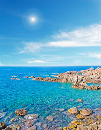 shining sun over Costa Paradiso rocky coast