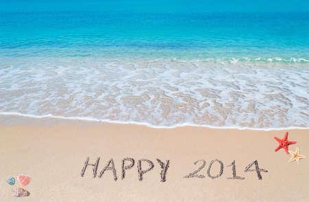 happy 2014 written on a tropical beach