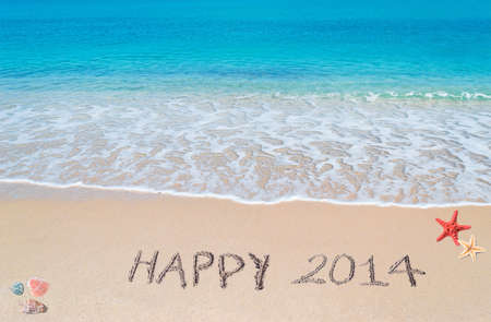 happy 2014 written on a tropical beach