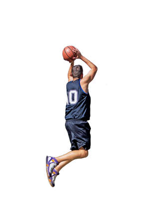 basketball player dunking on white background Stock Photo