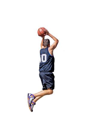 basketball player dunking on white background Stock Photo