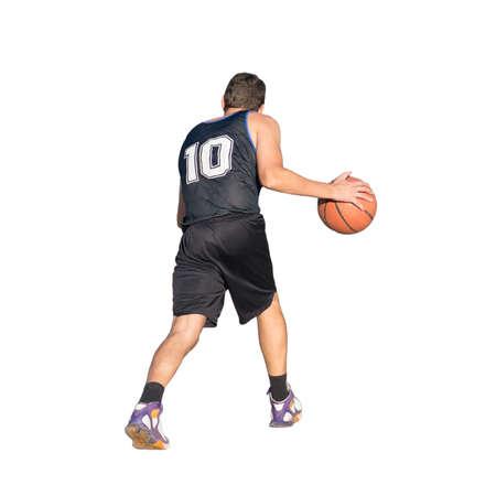 dribbling: basketball player dribbling on white background Stock Photo