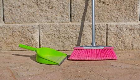 bioclean: green shovel and pink broom
