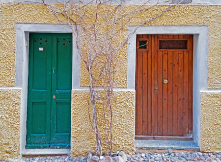 two old doors in a beige wall photo