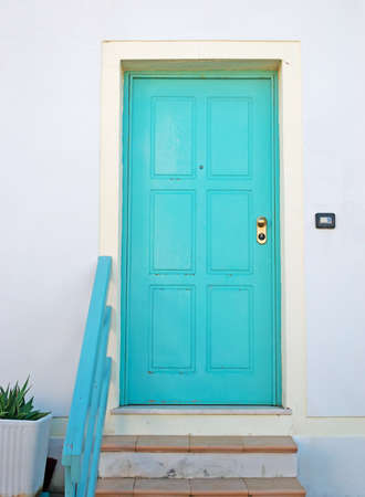 turquoise door and white wall in Sardinia photo