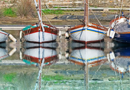 boats reflected in the port water