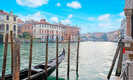 glimpse: glimpse of Venice under a blue sky with clouds