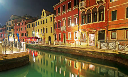 detail of a Venice canal at night