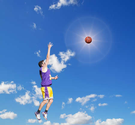 basketball player shooting in the sun photo
