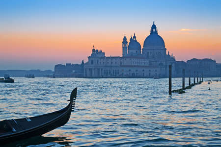 gondola in Venice Grand Canal at sunset photo