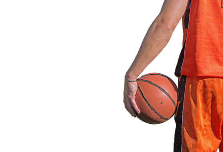 backview of a basketball player holding the ball isolated on white background photo