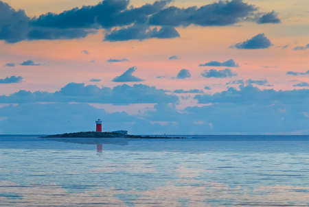sunset with lighthouse in Alghero, Italy photo