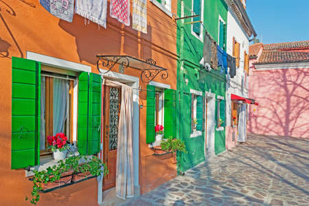 glimpse: colorful Burano houses on a clear day