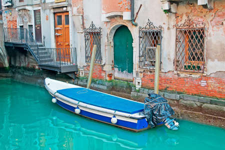 small boat in a Venice small canal photo