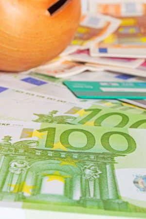 money box: money box, cash and credit cards Stock Photo