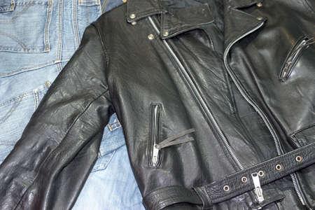 classic style leather studded jacket over denim pants photo
