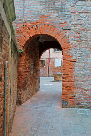 backstreet: old underpass in an antique Venice backstreet