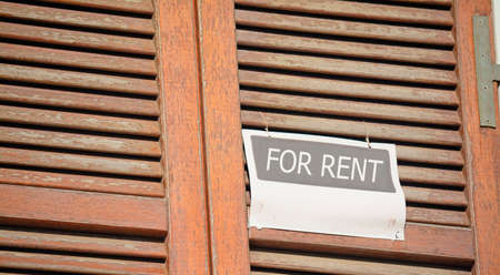 for rent sign: for rent sign in a wooden shutter