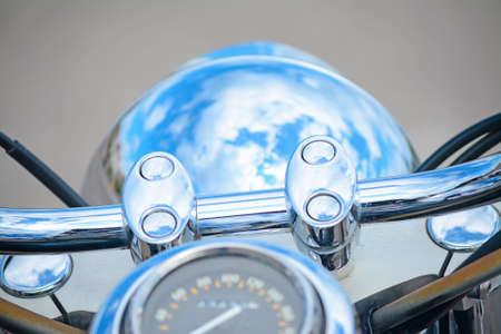 chromed: white clouds reflected in a chromed handlebar