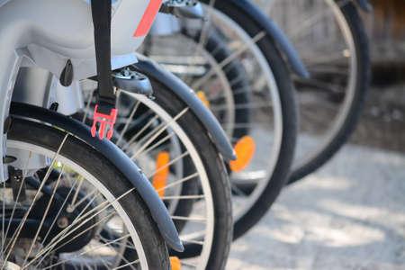 rental agency: detail of a bike wheel in a rental agency