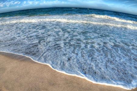 blue beach on a cloudy day, fisheye effect photo