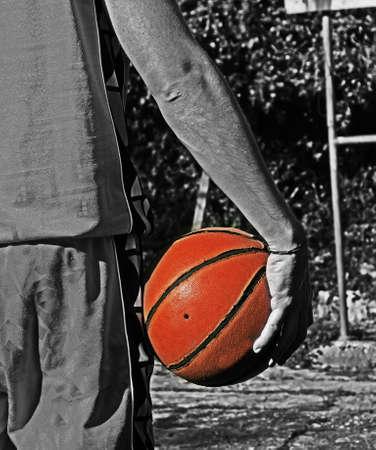 orange ball in a black and white playground photo