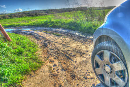 closeup of a car on a dirt road photo