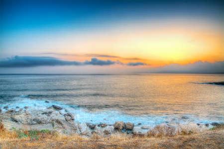 Alghero rocky shore at sunset photo