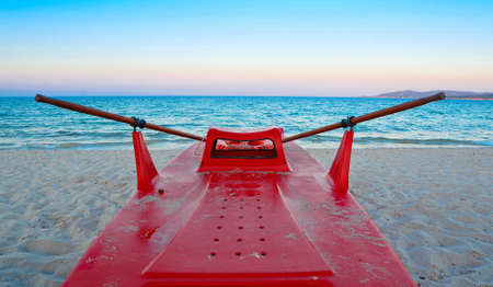 readiness: lifeboat on the shore at dawn Stock Photo