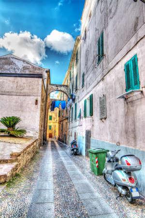 narrow street in Alghero old town, Sardinia photo