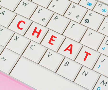 predictor: close up of a white and pink laptop keyboard with cheat buttons Stock Photo