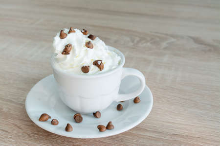coffee jelly: close up of a cup of coffee with whipped cream and chocolate chips