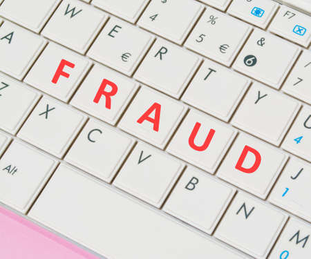 predictor: close up of a white and pink laptop keyboard with FRAUD buttons Stock Photo