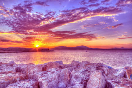 purple sunset in Alghero harbor, Sardinia. hdr tone mapping.