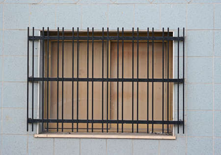 close up of a window with metal grill photo