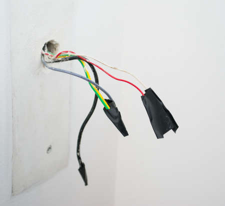 electrical safety: close up of electrical wires with tape