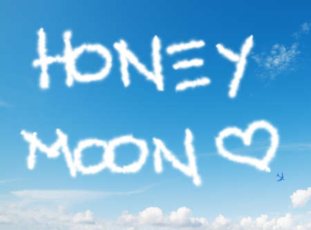 honey moon: honey moon written in the sky with contrails left by airplane