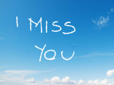 i miss you: i miss you written in the sky with contrails left by airplane