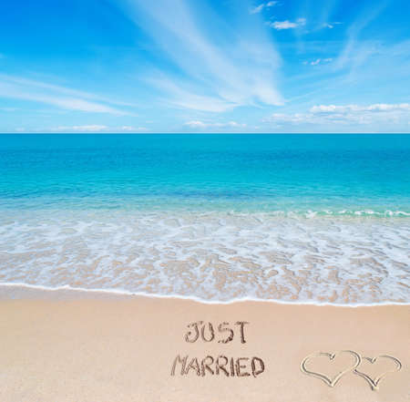 just married written on a tropical beach photo