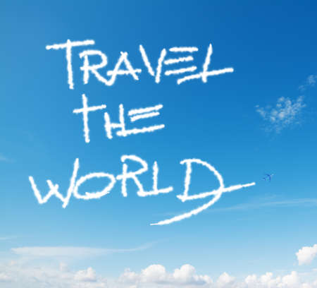 world travel: travel the world written in the sky with contrails left by airplane