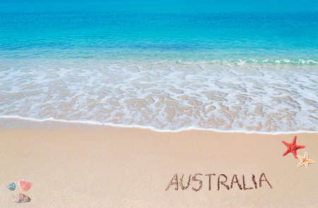 australia written on a tropical beach Stock Photo