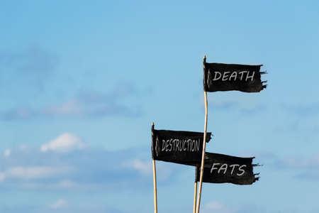 \death, destruction, fats, written on three black flags Stock Photo