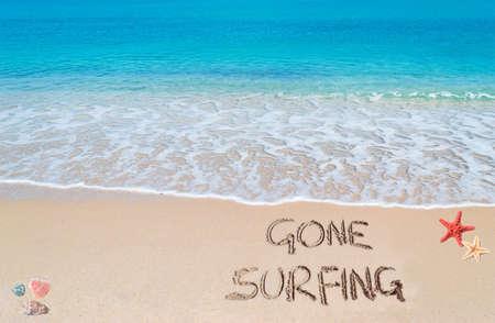 gone: \gone surfing\ written on a tropical beach