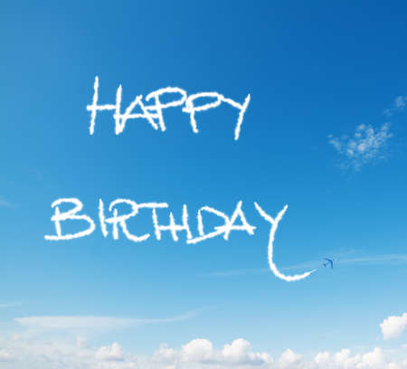 \happy birthday\ written in the sky with contrails left by airplane 版權商用圖片
